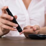 42545430 - close-up of woman hands testing high blood sugar with glucometer
