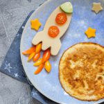 72397506 - kids funny breakfast with cheese sandwich and a omelette